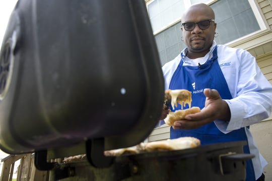 Chef Aaron McCargo grills up some turkey burgers, made with jalapenos, lime and smoked mozzarella in this file photo. McCargo is known for his bold flavors, love of spice and family-friendly comfort foods.