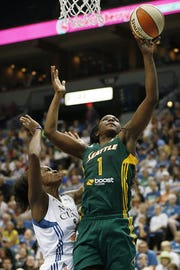 Crystal Langhorne (right) and her Seattle Storm team are one win away from a WNBA championship. The Willingboro High School graduate tries to make the most of her minutes off the bench for the Storm.