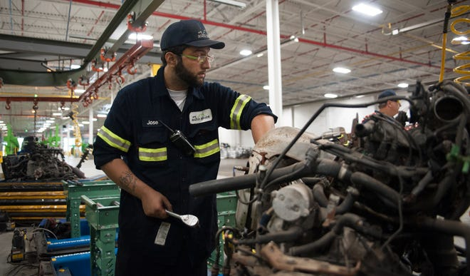 Jose Delgado of Camden demanufactures a car engine while working at the EMR Eastern plant in South Camden on Monday, September 10, 2018.  EMR Eastern LLC CEO Joe Balzano Jr. is looking to hire as many as 275 new employees for his plant in South Camden.