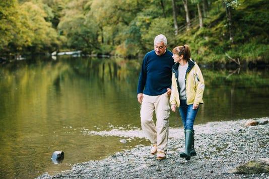 Senior Couple Walking Round The Lake District