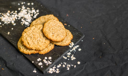Peanut Butter Oatmeal Cookies Against Black Background