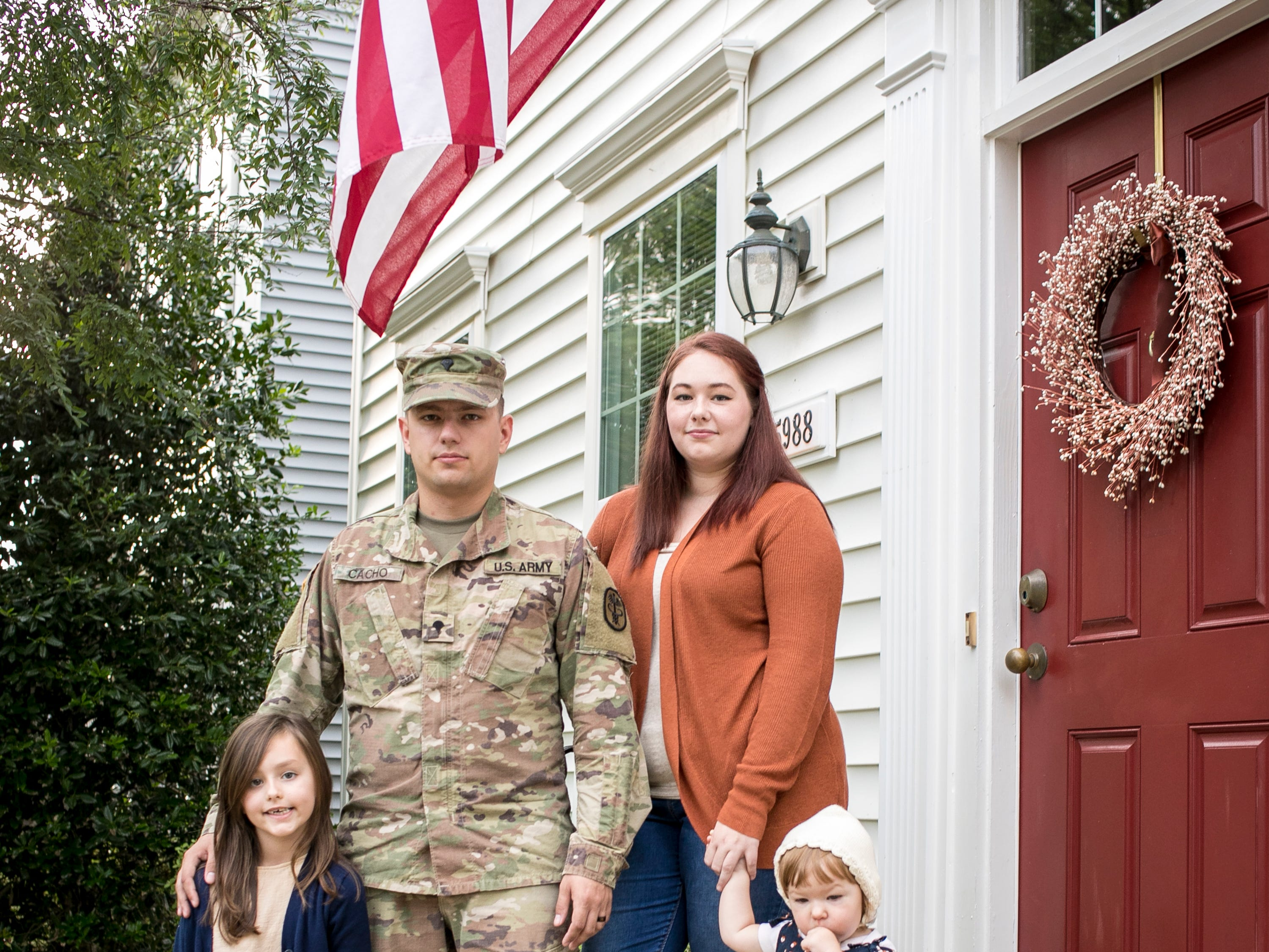 Specialist Christopher Cacho and his wife, Andrea, at Ft. Belvoir with their daughters, Edith, 19 months, and Lea, 7, on Tuesday, September 4, 2018. The Cachos had a terrible experience with a move from Ft. Campbell to Ft. Belvoir back in July. Many of their pieces of furniture were scratched and damaged. Books had water damage, including a family Bible. But the worst may have been the wedding rings that disappeared.