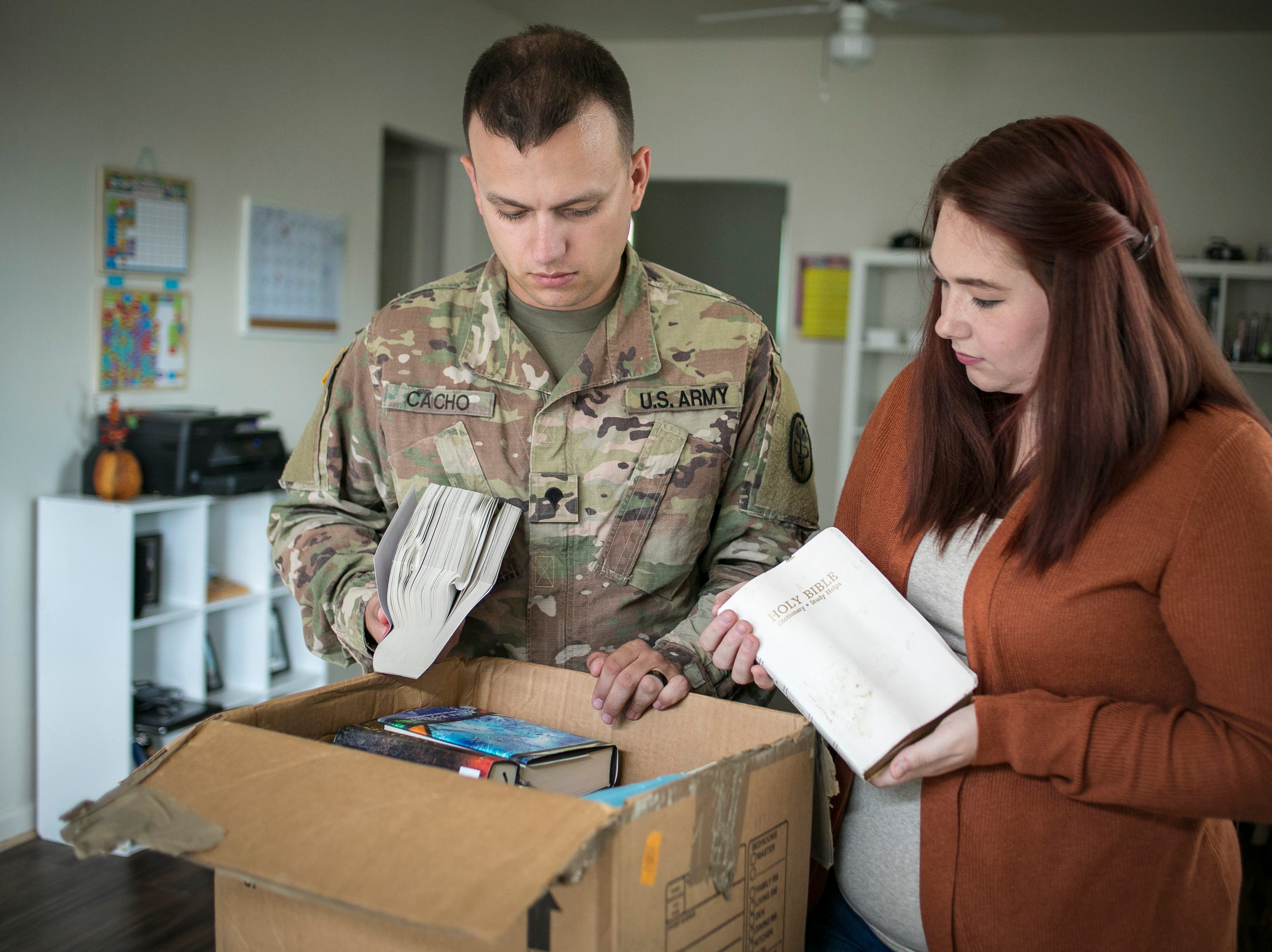 Specialist Christopher Cacho and his wife, Andrea look through their damaged books, after a bad experience moving from Ft. Campbell to Ft. Belvoir back in July. September 4, 2018.