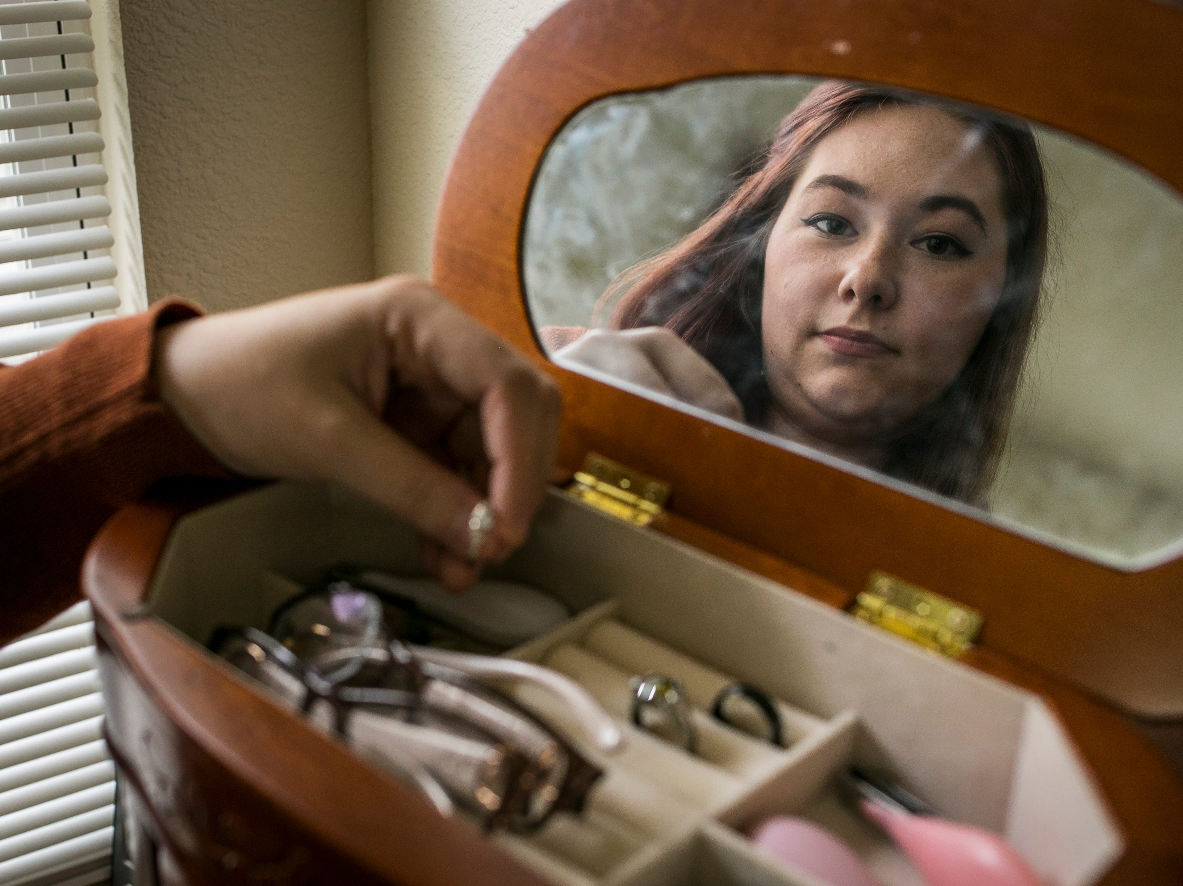 Andrea Cacho looks through her jewelry box where her wedding rings were located before her move to Ft. Belvoir. Cacho believes the rings were stolen by her movers.