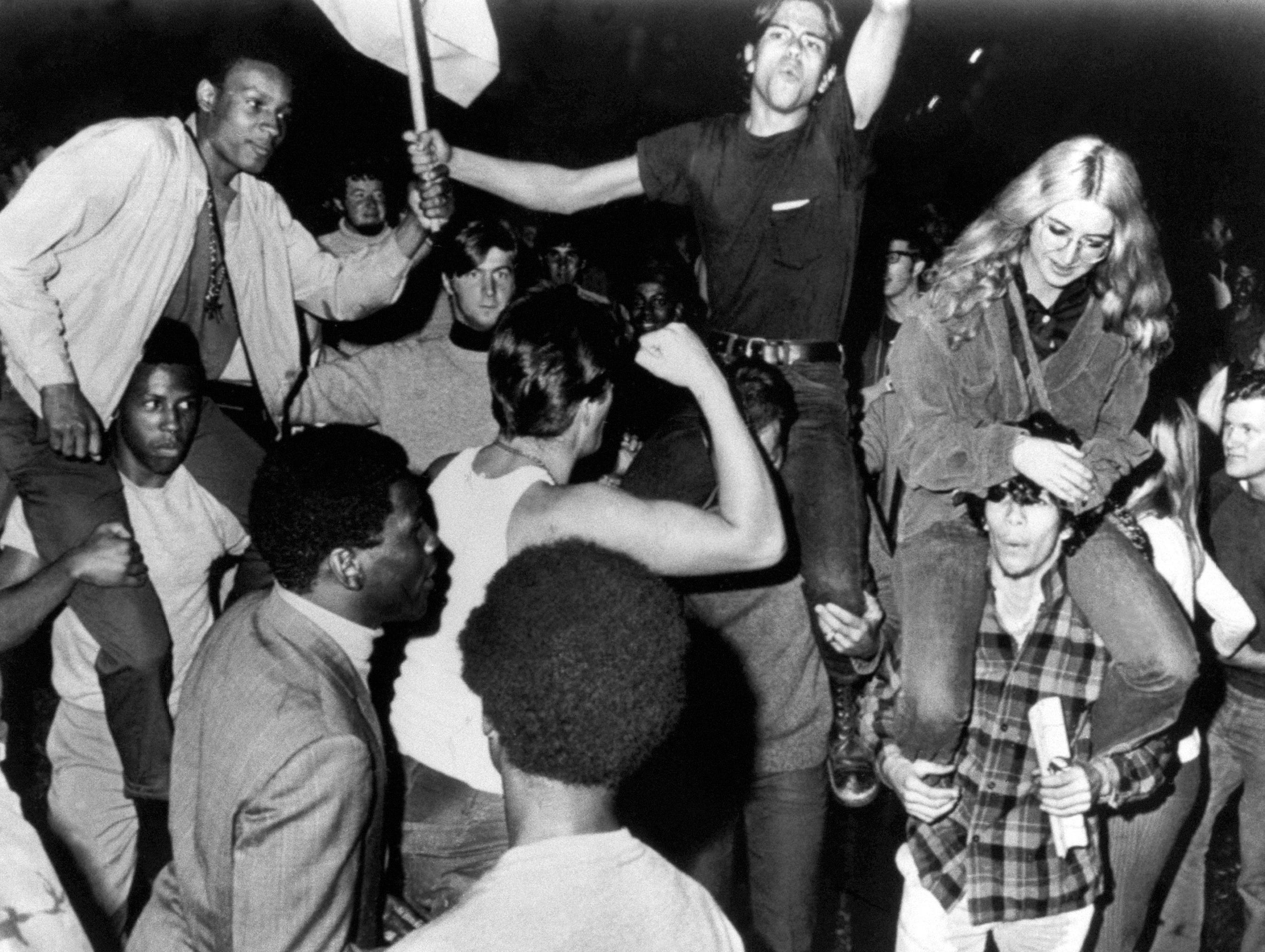 Protesters whoop it up before being chased from Chicago's Lincoln Park on August 26, 1968. They were in town to demonstrate at the Democratic National Convention.