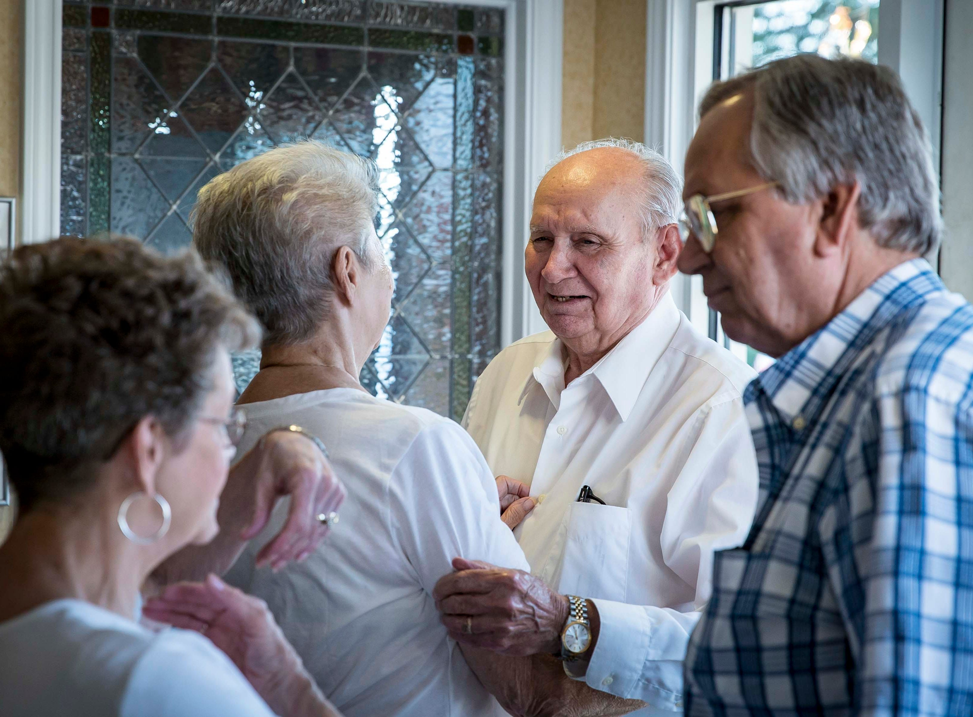 "Bobby Sexton, center, half-brother to A.W. ""Dub"" Barron, greets family during a reunion on Saturday Sept. 1, 2018, in Tyler, Texas."