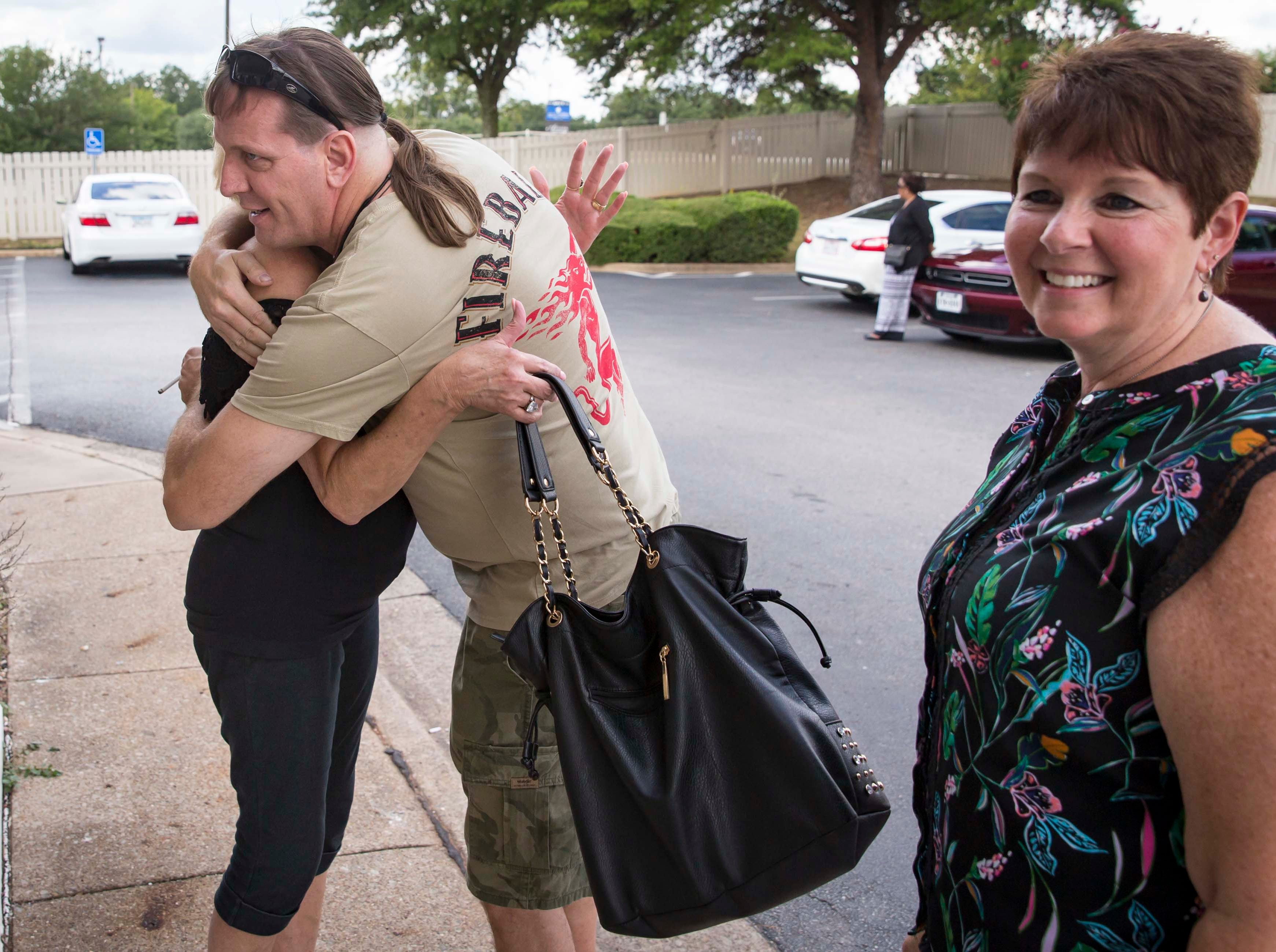 Wade Mulligan of Las Vegas, greets his half-sister Shelia Barron Jenkins of Dallas, Texas, for the first time in Tyler, Texas, Saturday, Sept. 1, 2018. At right is their half-sister Connie Hoye.