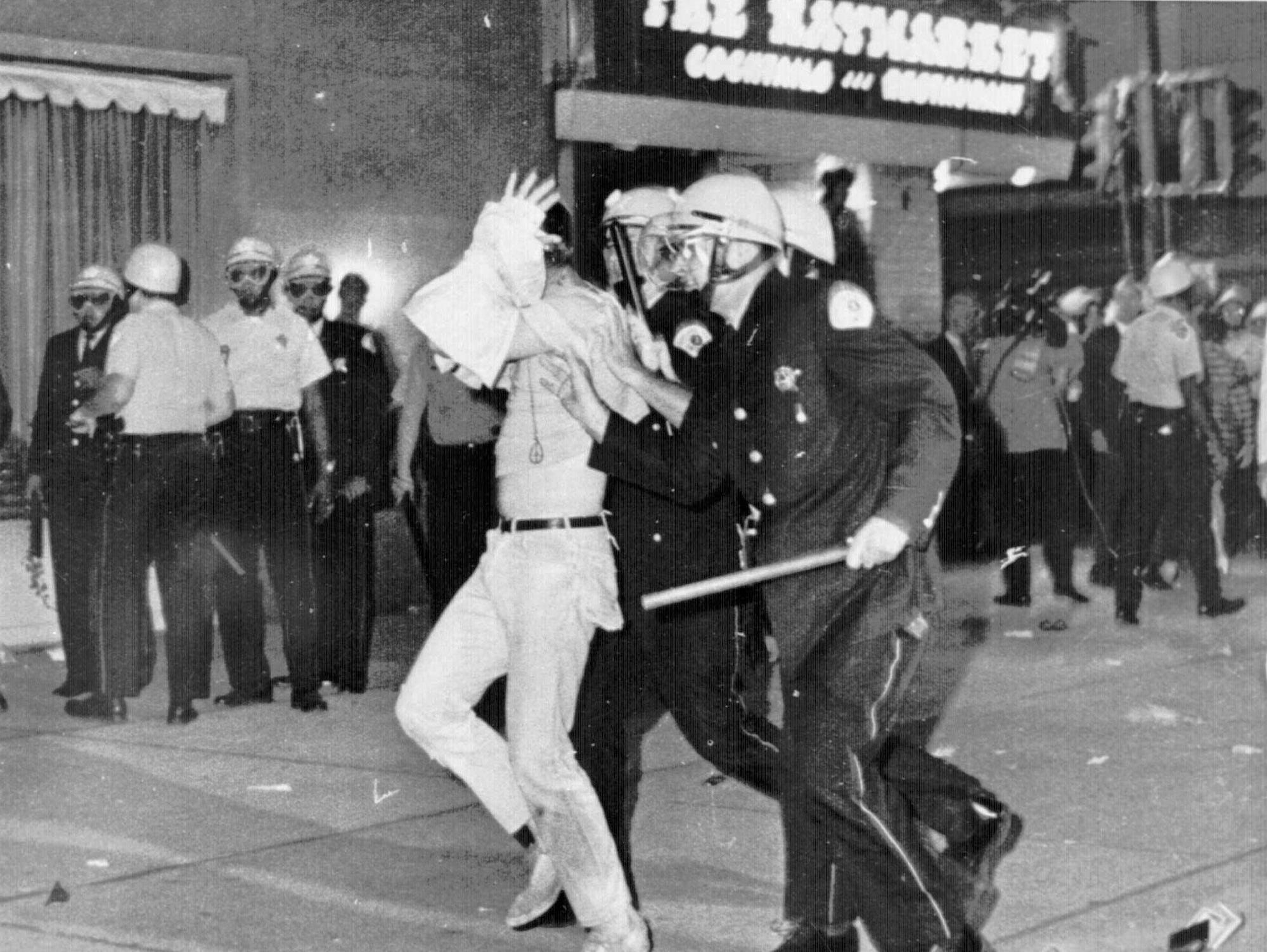 A demonstrator with his hands on his head is led by Chicago police down Michigan Avenue on Aug. 28, 1968, during a confrontation with police and National Guardsmen who battled demonstrators near the Conrad Hilton Hotel, headquarters for the Democratic National Convention. During the convention, hundreds of demonstrators waged war with police and National Guardsmen on the streets of Chicago.