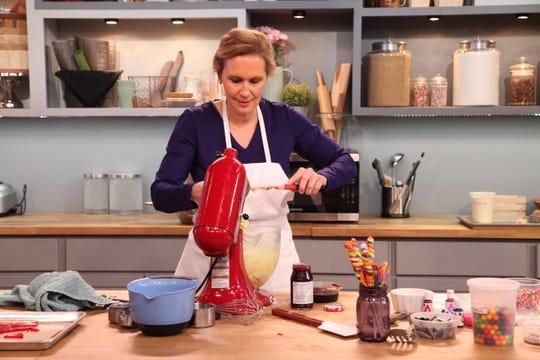 Eileen mixes icing.