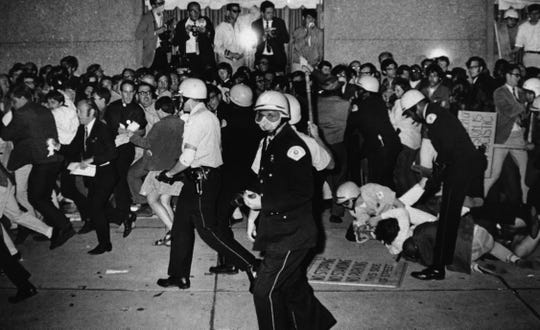 Chicago police attempt to disperse demonstrators outside the Conrad Hilton, the downtown headquarters for the Democratic National Convention in Chicago, on Aug. 29, 1968. During the convention, hundreds of demonstrators waged war with police and National Guardsmen on the streets of Chicago.