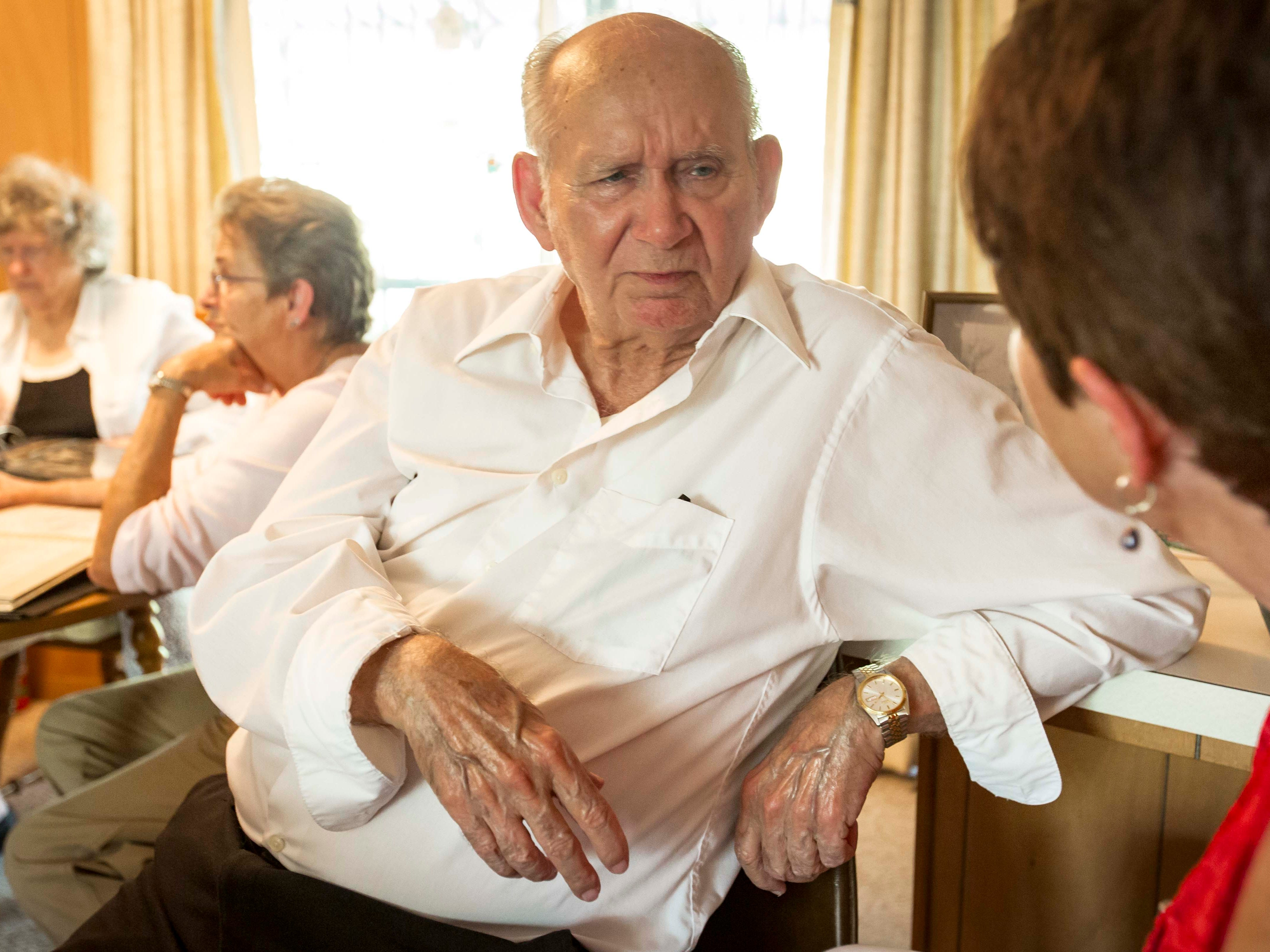 "Bobby Sexton, center, talks with Connie Hoye, right, at his home in Tyler, Texas, Sunday, Sept. 2, 2018, during a reunion of the known children of A.W. ""Dub"" Barron."