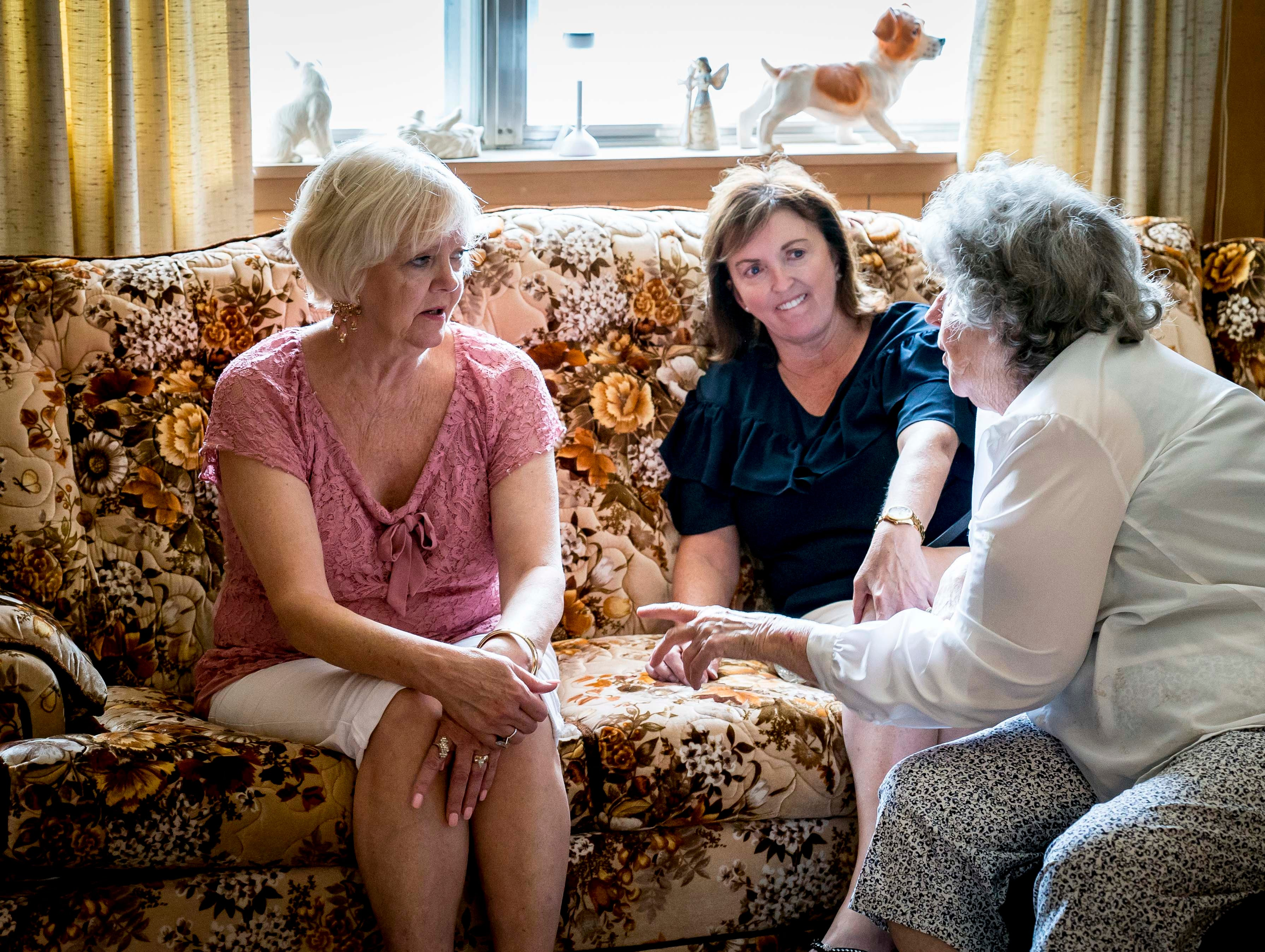"Shelia Barron Jenkins of Dallas, Texas, left, and Lori Stangl of Omaha, Nebraska, both children of A.W. ""Dub"" Barron,  talk with Helen Sexton, right, wife of Barron's half-brother Bobby Sexton, in Tyler, Texas, Sunday, Sept. 2, 2018."