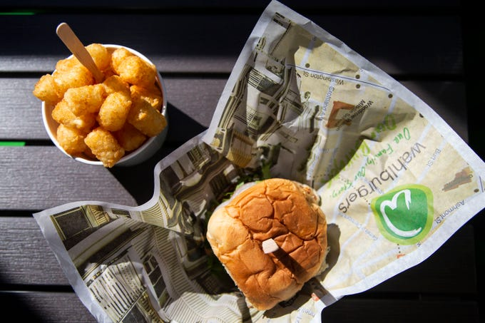 The Our Burger with a side of tater tots served up at Iowa's first Wahlburgers location on Monday, Sept. 10, 2018, in the Jordan Creek Town Center in West Des Moines. The restaurant, created by actor Mark Wahlberg and his brothers, will open on on Sept. 11.