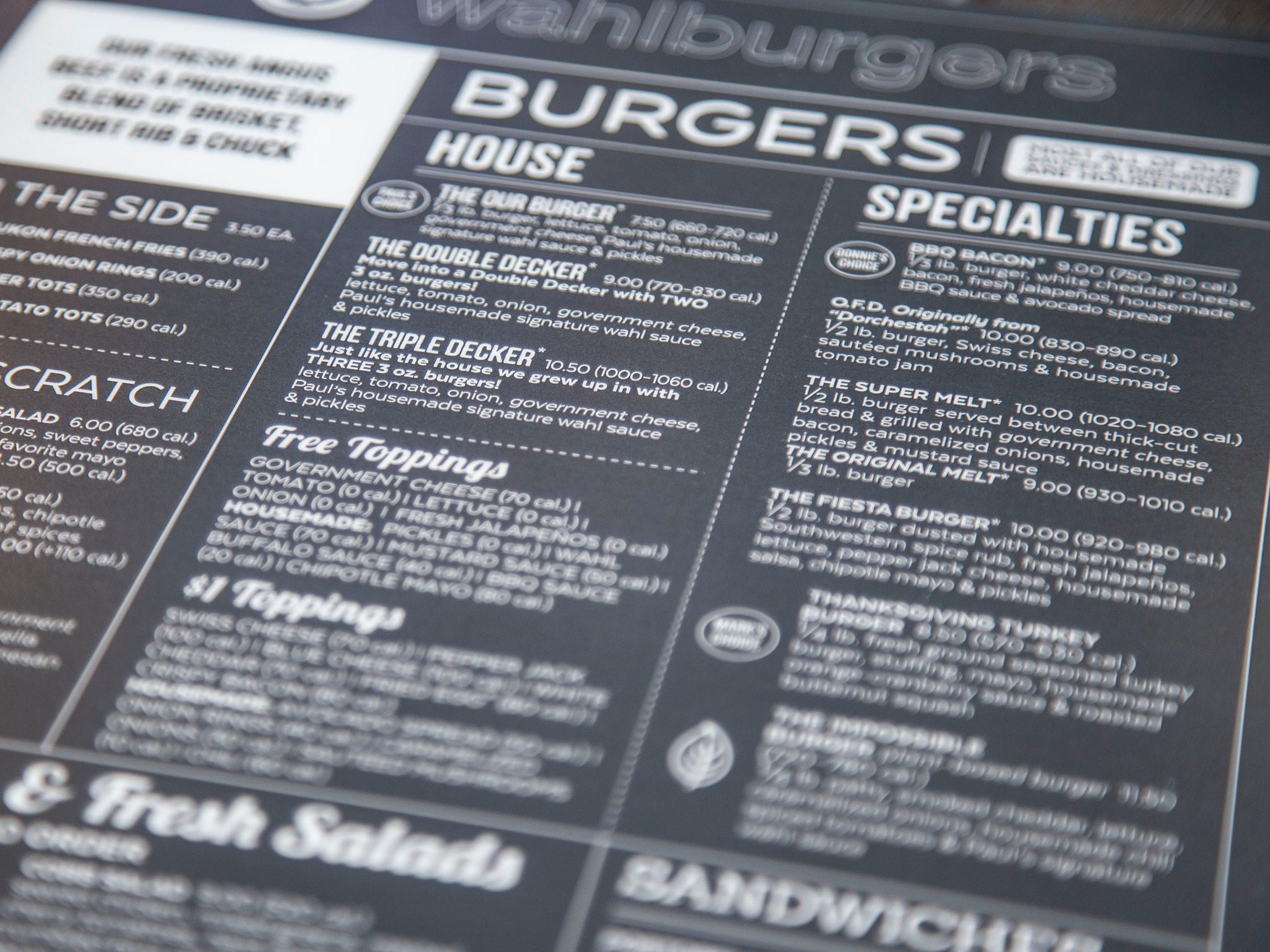 The menu at Wahlburgers includes burgers and other food items inspired by the Wahlberg brothers, on Monday, Sept. 10, 2018, in the Jordan Creek Town Center in West Des Moines.