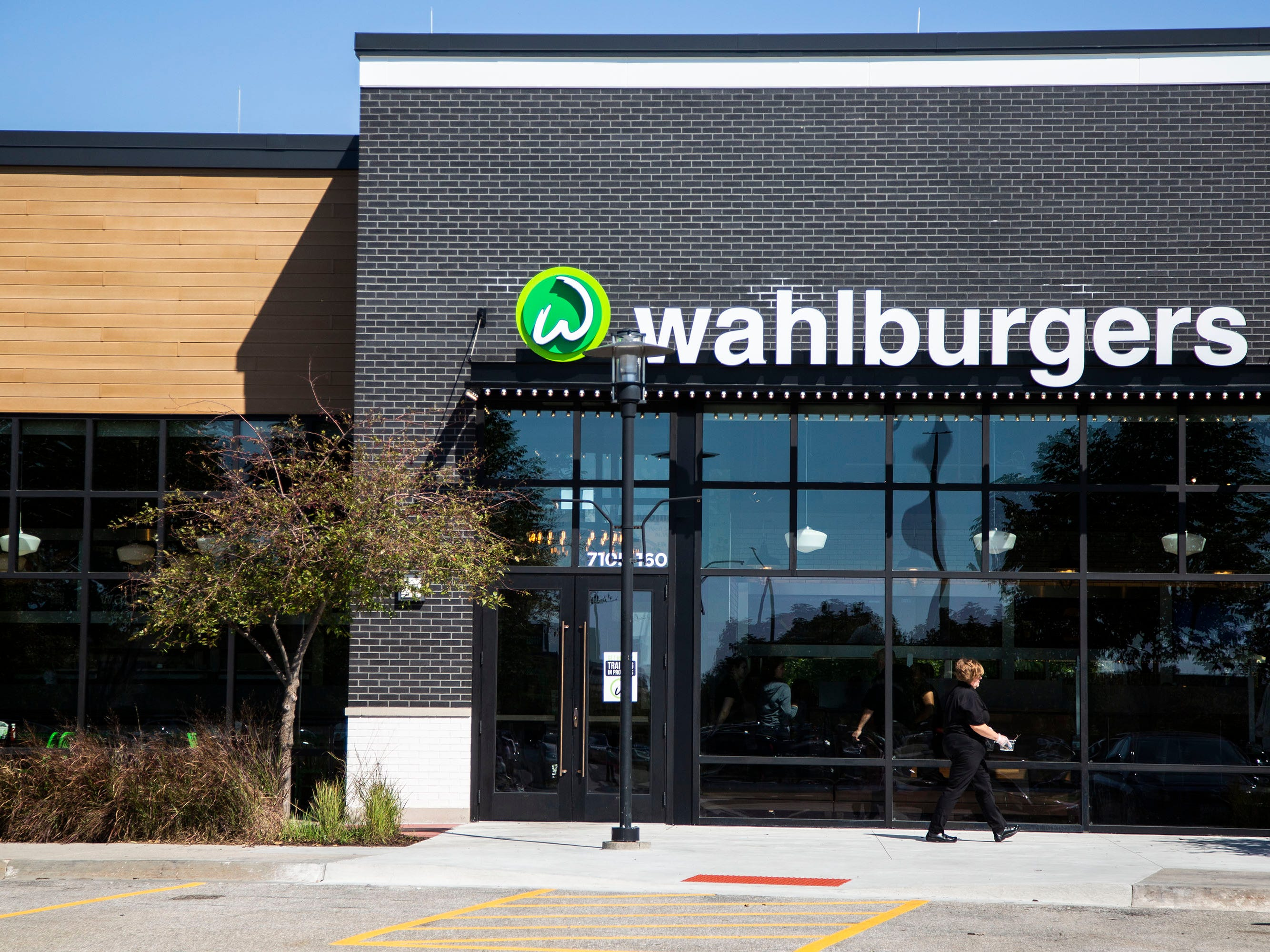 Staff prepare for opening day at Wahlburgers on Monday, Sept. 10, 2018, in the Jordan Creek Town Center in West Des Moines. Hy-Vee is bringing 26 locations of the burger restaurant to the midwest.