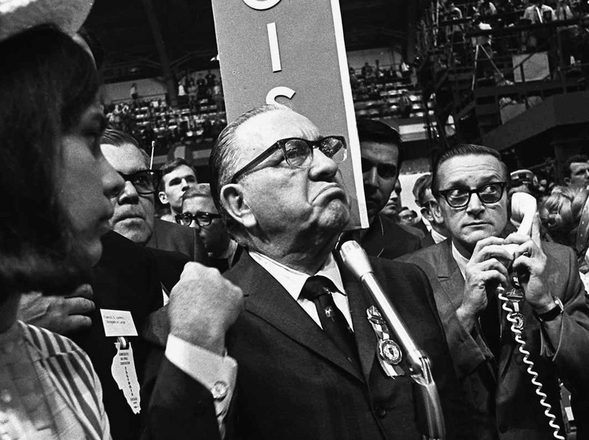 Chicago Mayor Richard J. Daley stands at the microphone as shouts resound through the International Amphitheatre in Chicago on Aug. 28, 1968, demanding that the Democratic National Convention adjourn until later in the day before considering the party platform. During the convention, hundreds of demonstrators waged war with police and National Guardsmen on the streets of Chicago.