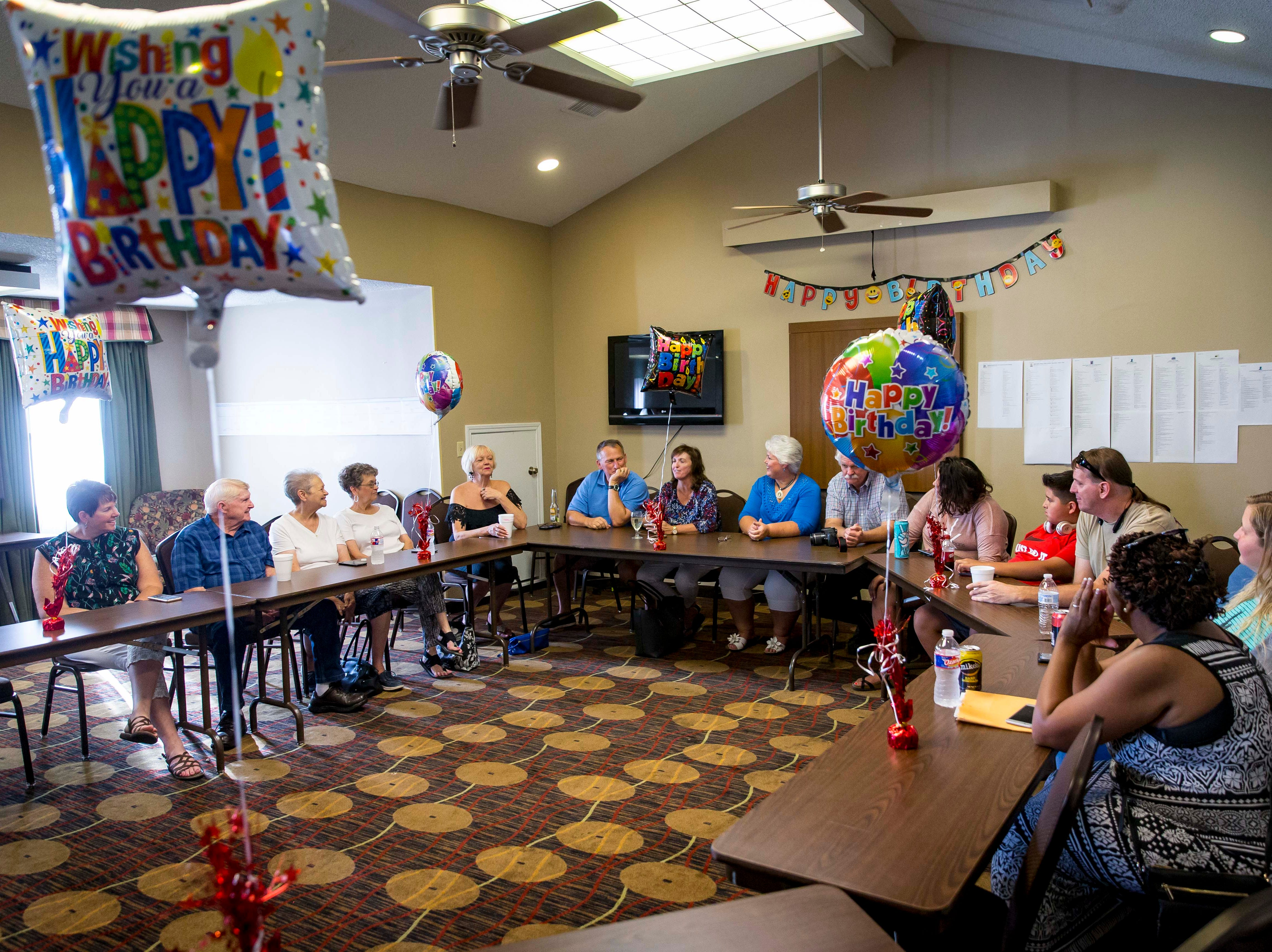 "The adult children of A.W. ""Dub"" Barron meet at a family reunion on Saturday, Sept. 1, 2018, in Tyler, Texas. Family and friends met to share their memories and photos of a father they didn't realize they shared until recently."