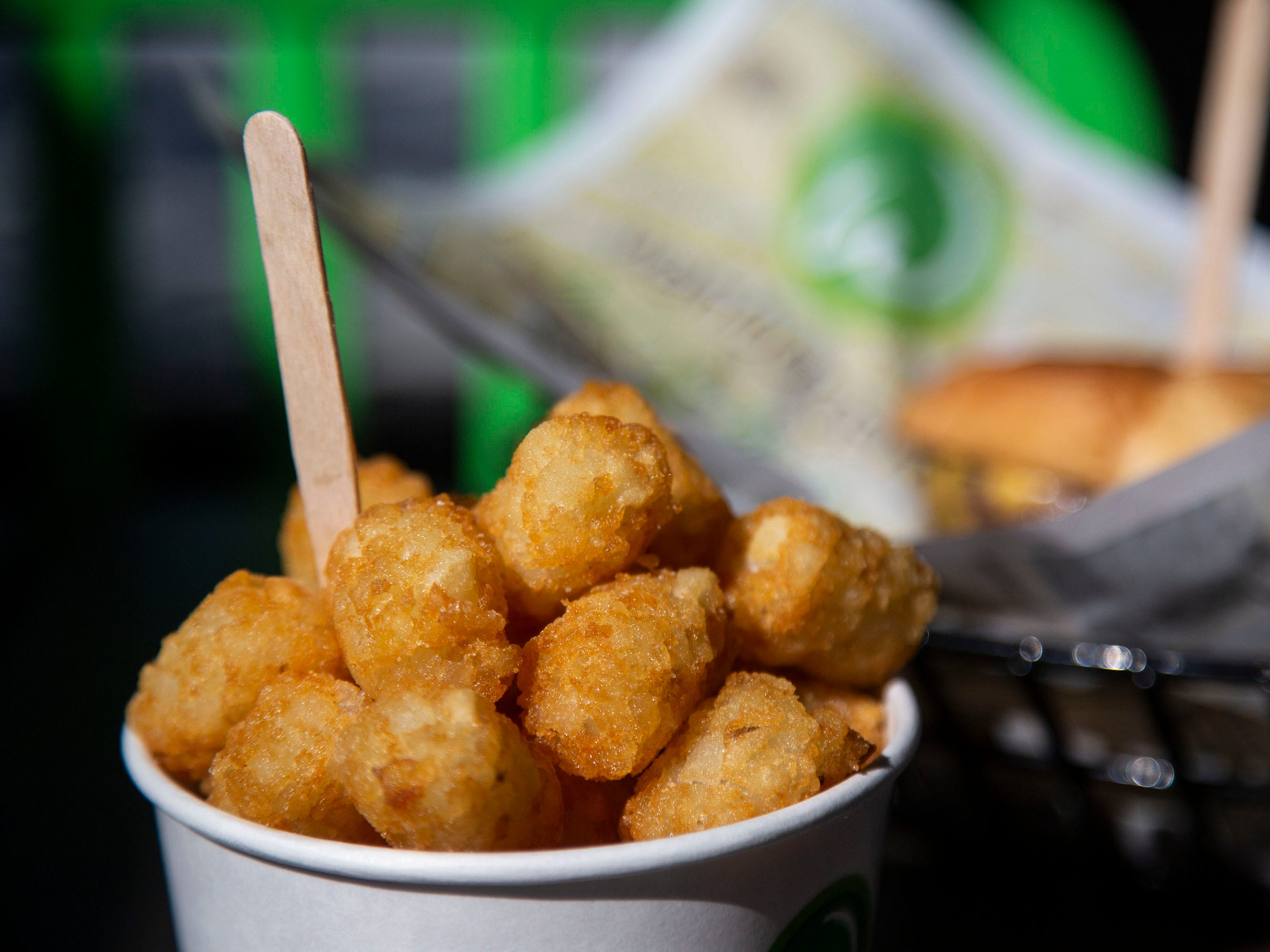 Wahlburgers tater tots are served along side a burger the day before the restaurant's opening on Monday, Sept. 10, 2018, in the Jordan Creek Town Center in West Des Moines. The restaurant, created by actor Mark Wahlberg and his brothers, will open on on Sept. 11.
