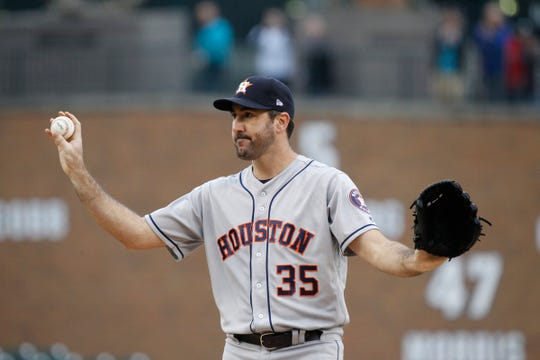 Houston Astros starting pitcher Justin Verlander waves to his former home crowd as he takes the mound in the first inning to face the Detroit Tigers, Monday, Sept. 10, 2018 at Comerica Park in Detroit.