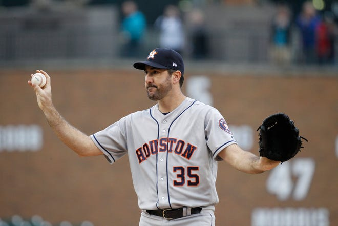 Justin Verlander waves to his former home crowd as he takes the mound in the first inning to face the Tigers, Monday, at Comerica Park.