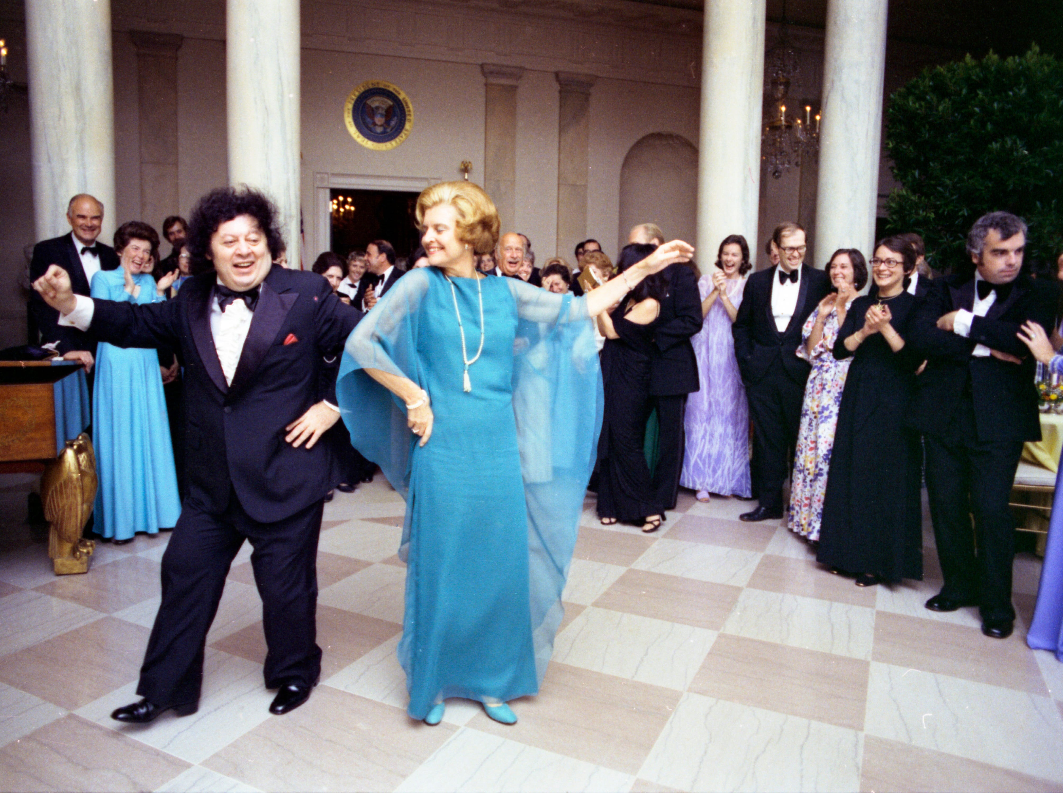 First Lady Betty Ford and Comedian Marty Allen dancing in the Grand Hall of the White House following a State Dinner honoring the President of Liberia. Sept. 21, 1976.
