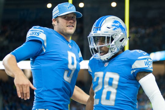 Detroit Lions safety Quandre Diggs, right, celebrates his touchdown with quarterback Matthew Stafford during the first quarter against the New York Jets at Ford Field on Sept. 10, 2018 in Detroit.