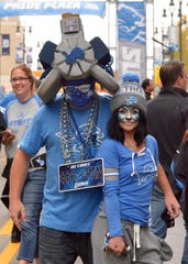 Ward Elliott, 34, of Detroit, and Sara Johncox, 20, of Romulus, were dressed for success for the Detroit Lions' season-opening game against the New York Jets on Monday, Sept. 10, 2018.