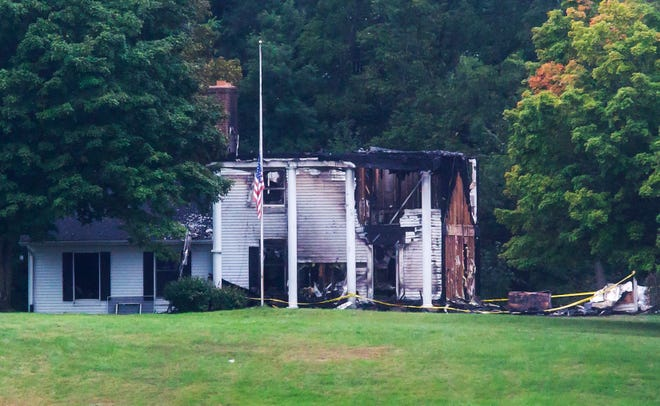 Police tape surrounds the family home of Republican lieutenant governor nominee Lisa Posthumus Lyons in the Kent County community of Alto, Mich., Monday, Sept. 10, 2018. The home was significantly damaged in a fire on Sunday.