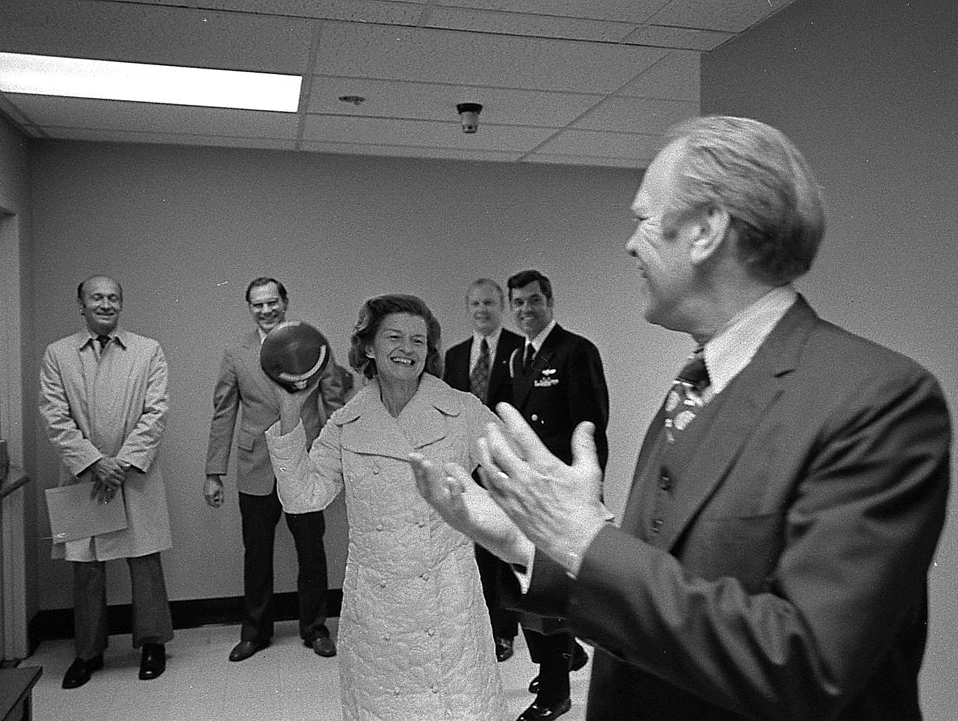 Eager to show everyone how well she was recovering, Betty tossed a football, a gift from Washington Redskins coach George Allen, to President Ford in the hospital hallway, barely a week after her breast cancer surgery.