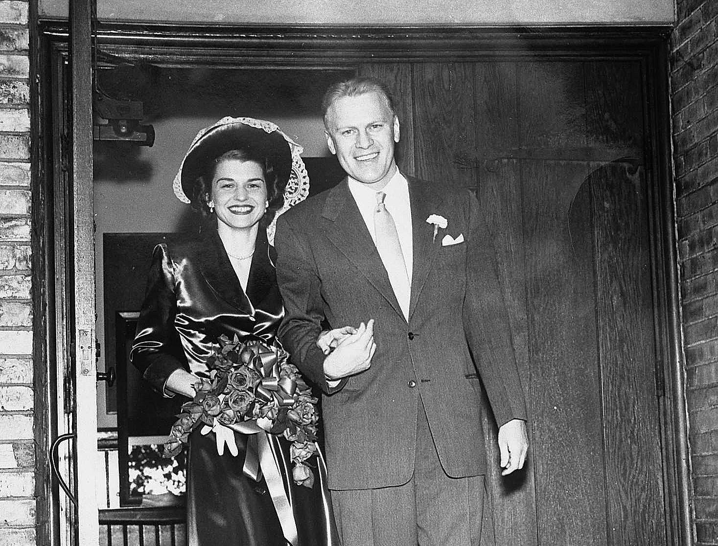 Joyful newlyweds, Betty and Gerald Ford, on their wedding day, October 15, 1948 in Grand Rapids.