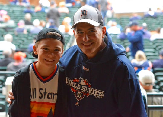 Evan Tappy, 11, and his father, Lee, went to Comerica Park to see Justin Verlander pitch against the Detroit Tigers. Tappy was a Tigers fan until Verlander was traded to the Houston Astros.