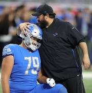 Detroit Lions head coach Matt Patricia talks with guard Kenny Wiggins before action against the New York Jets on Monday, Sept. 10, 2018, at Ford Field in Detroit.