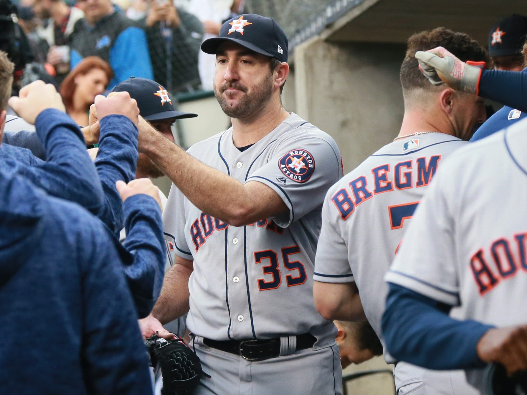 Astros pitcher Justin Verlander (35) fist bumps teammates in the visitors dugout before the Detroit Tigers take on the Houston Astros Monday, Sept. 10, 2018, at Comerica Park.