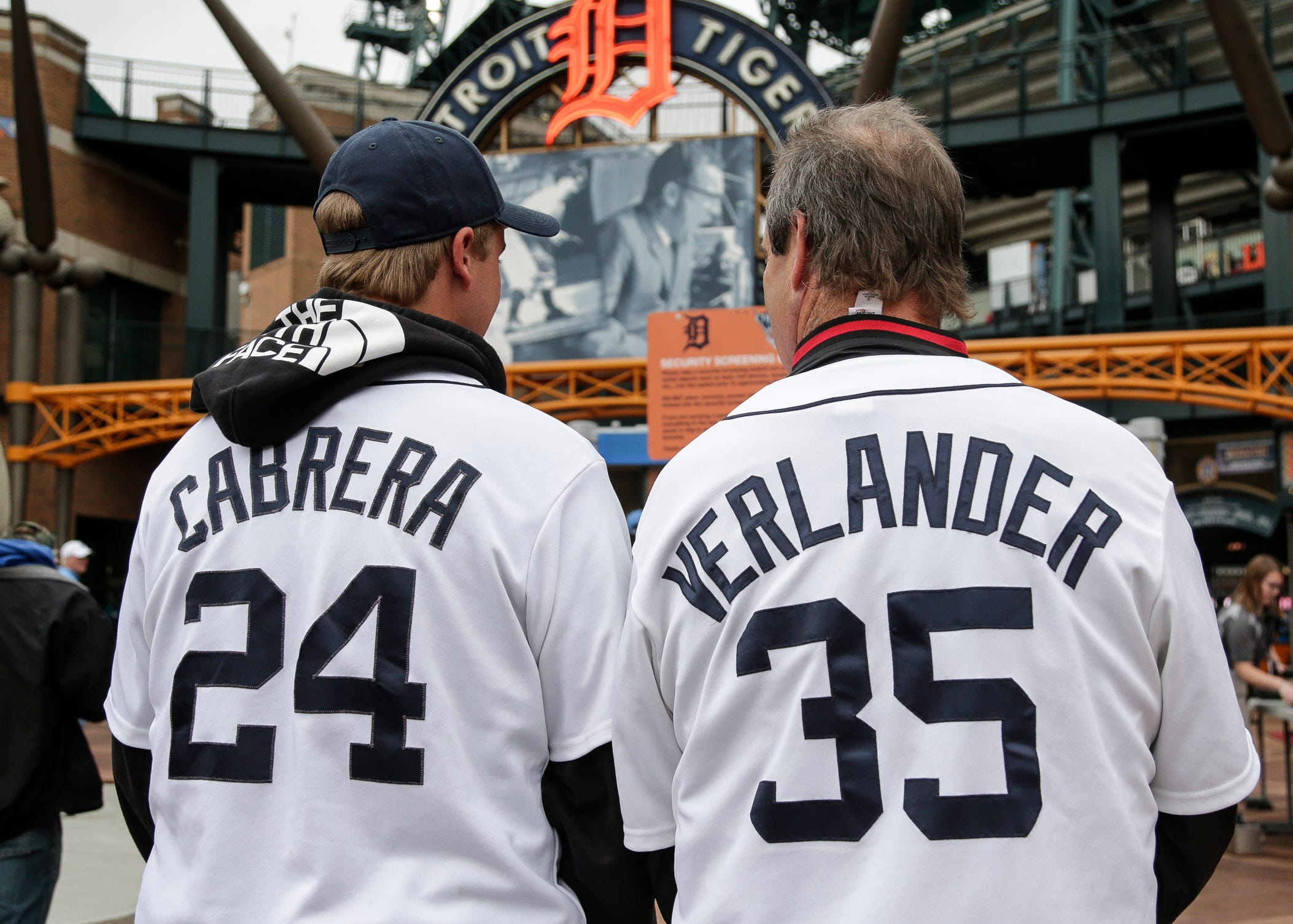 Brandon Meadows, 17, of Livonia, left, talks to his father Tom Meadows, also of Livonia, wears a Justin Verlander jersey, as they enter Comerica Park before the Detroit Tigers-Houston Astros game on Monday, Sept. 10, 2018.