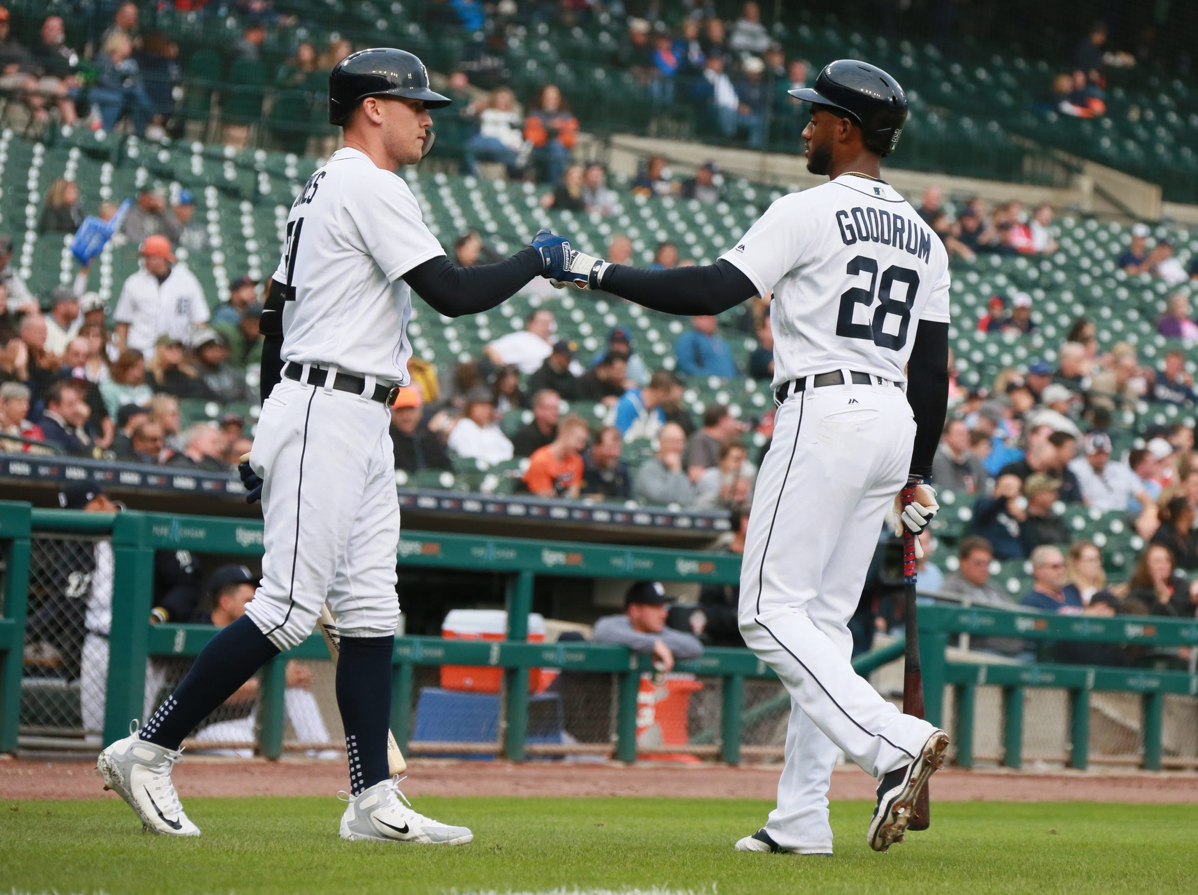Tigers center fielder JaCoby Jones, left, pounds it with first baseman Niko Goodrum after he scores the Tigers first run in the second inning on Monday, Sept. 10, 2018, at Comerica Park.