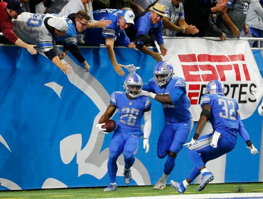 Detroit Lions' Quandre Diggs, left, celebrates his interception for a touchdown against the New York Jets in the first quarter in Detroit, Monday, Sept. 10, 2018.