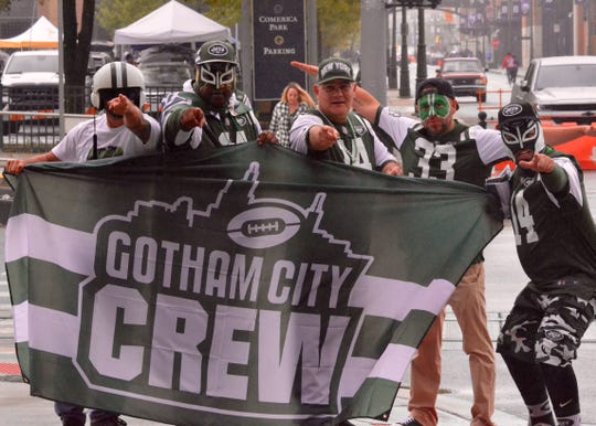 Members of the Gotham City Crew, the New York Jets' largest fan club, get ready for a game against the Detroit Lions on Sept. 10, 2018 in Detroit. The members, from left: Claudio Juarez, Civy Merritt, Frankie Delgado, Doug Colorado and Edward Delgado.