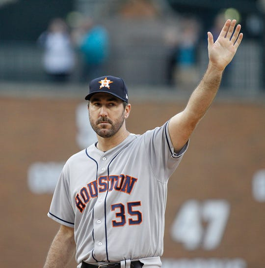 Astros pitcher Justin Verlander waves to his former home crowd as he takes the mound in the first inning against the Detroit Tigers on Monday, Sept. 10, 2018.