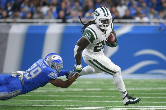 New York Jets running back Isaiah Crowell runs the ball past Detroit Lions cornerback Jamal Agnew during the first quarter at Ford Field on Sept. 10, 2018 in Detroit.