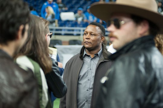 Detroit Lions Hall of Fame running back Barry Sanders talks to the Lanco band members before the game against the New York Jets at Ford Field on Sept. 10, 2018.