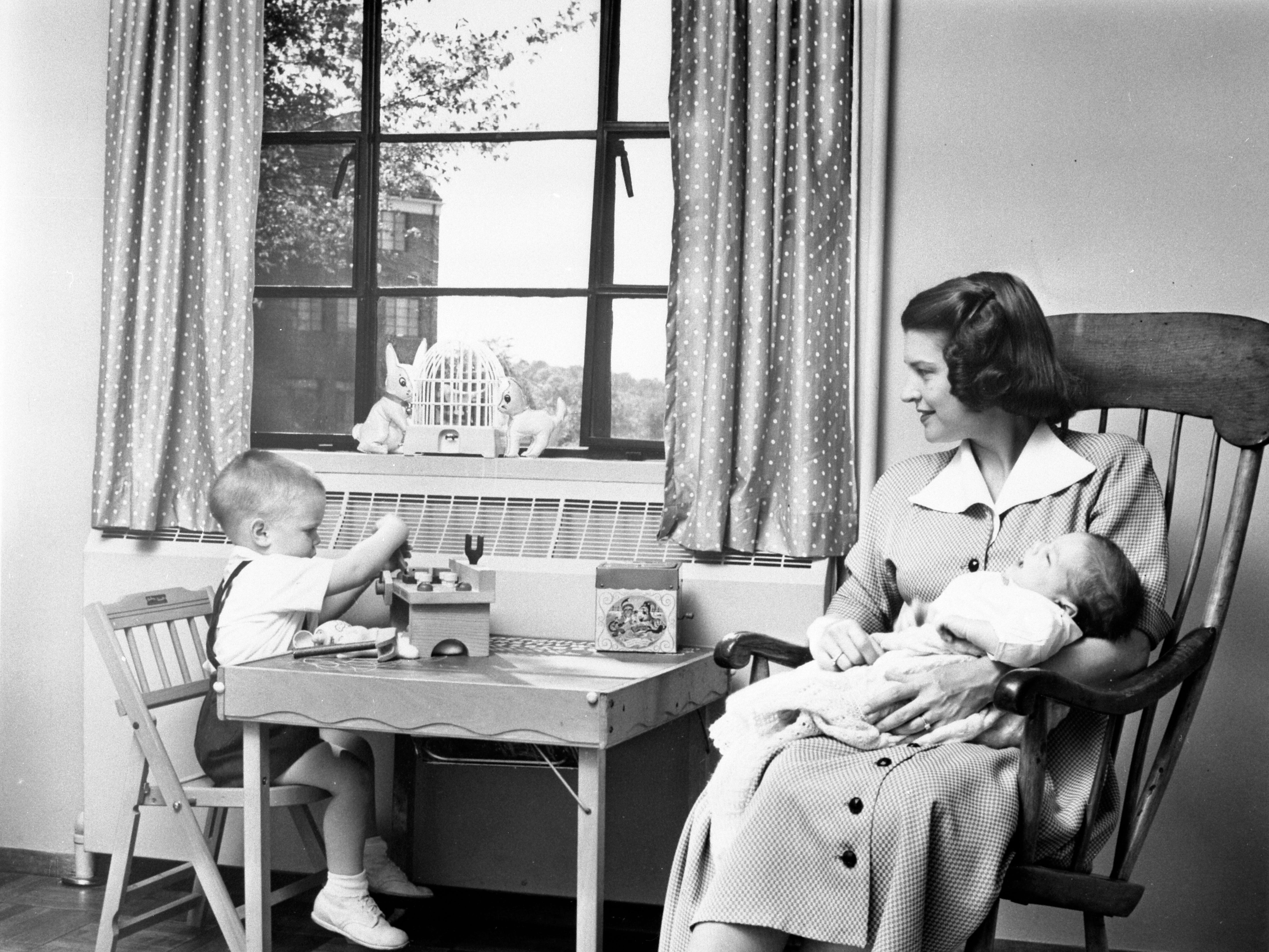 Betty, 34, with newborn Jack and two-year-old Michael in their apartment in Park Fairfax, VA, 1952.