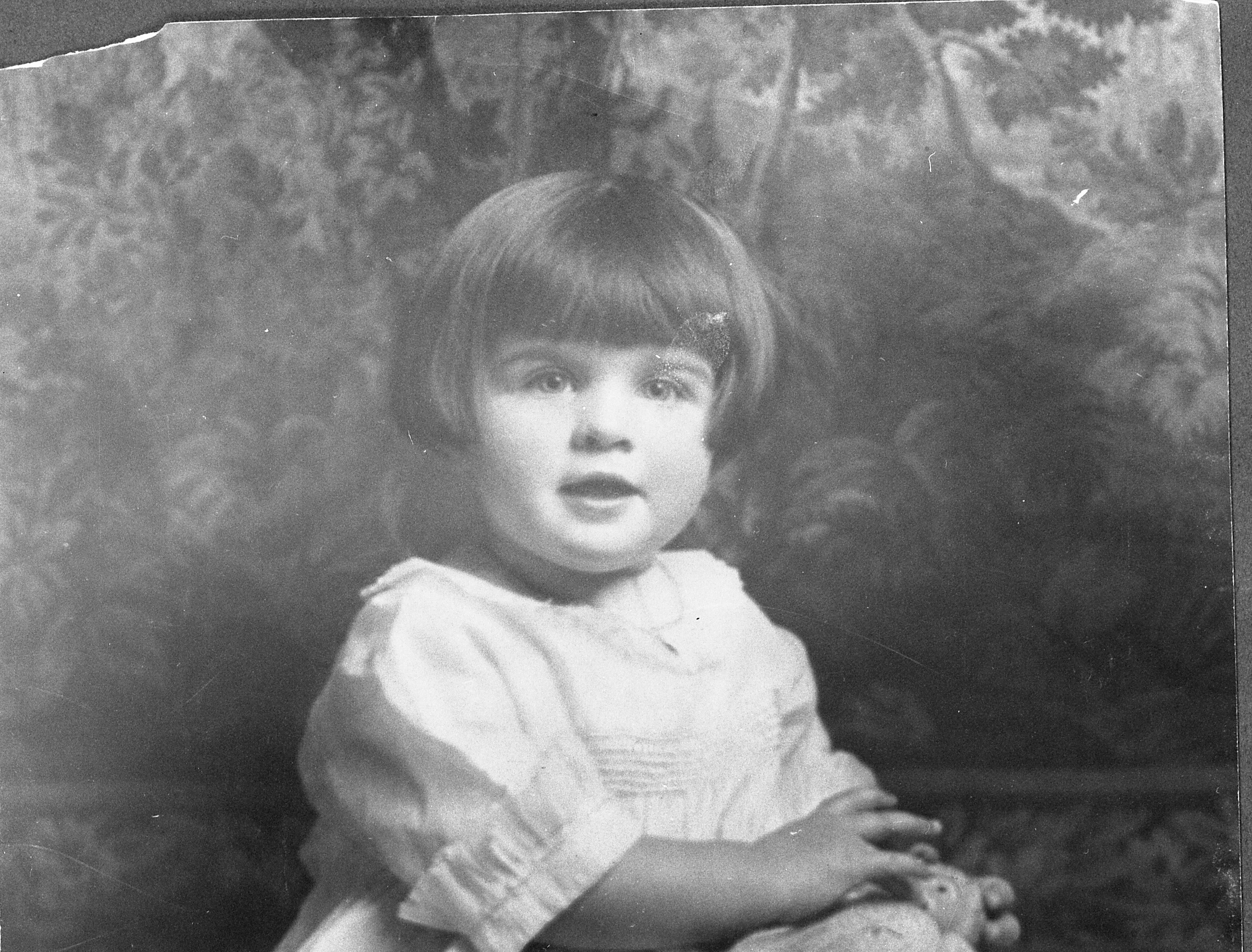 Betty, age 3, with her teddy bear.