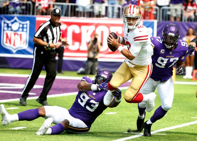 49ers quarterback Jimmy Garoppolo, center, is sacked by Vikings defensive tackle Sheldon Richardson (93) and defensive end Everson Griffen (97) during the first half on Sunday.