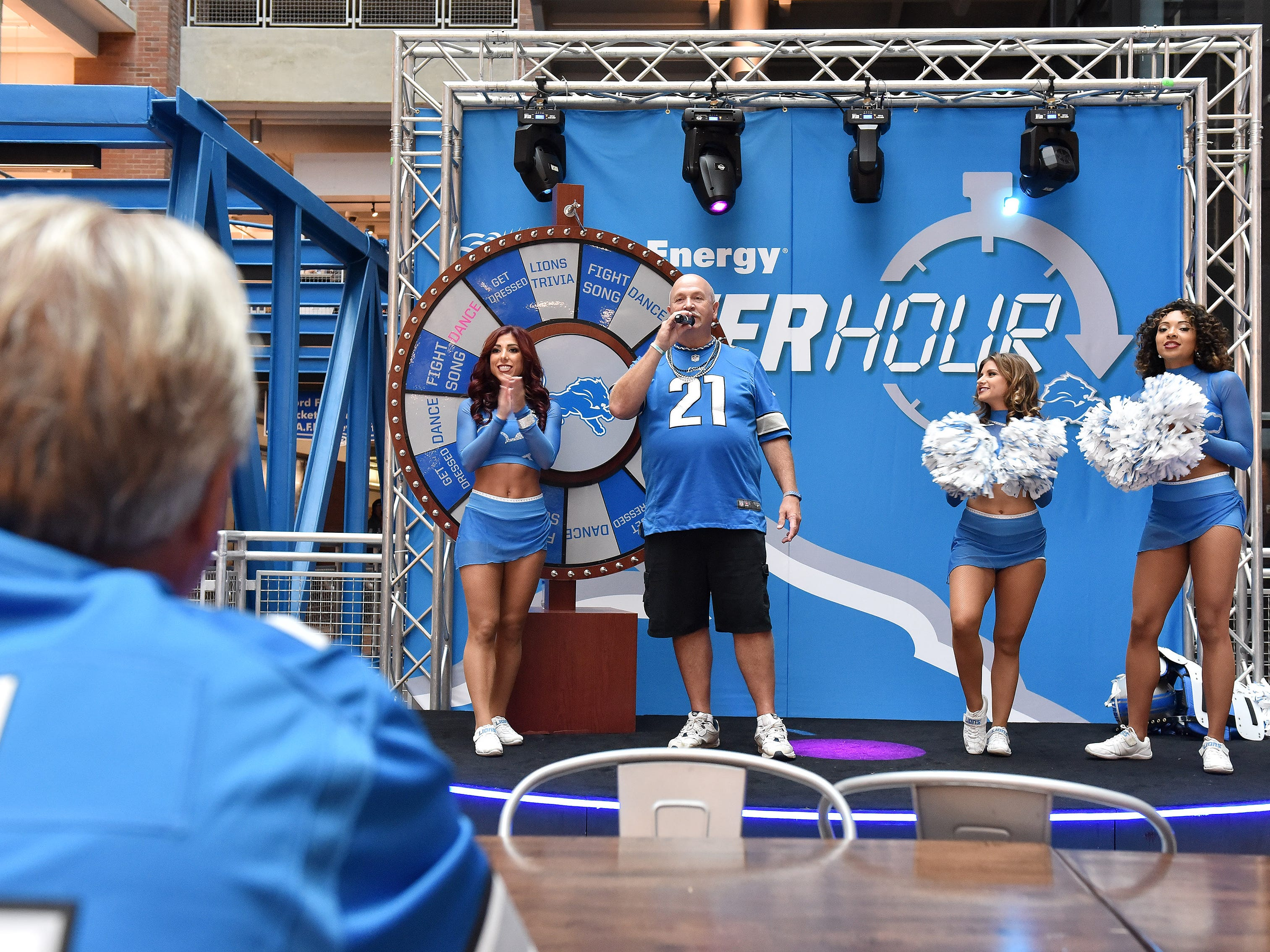 Joe Cichewicz of Waterford sings the Lions fight song during fan activities with the Lions cheerleaders before the game.