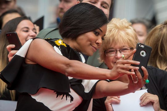 """Actress Gabrielle Union takes photos with fans at the red carpet for the premiere of the film """"The Public."""""""