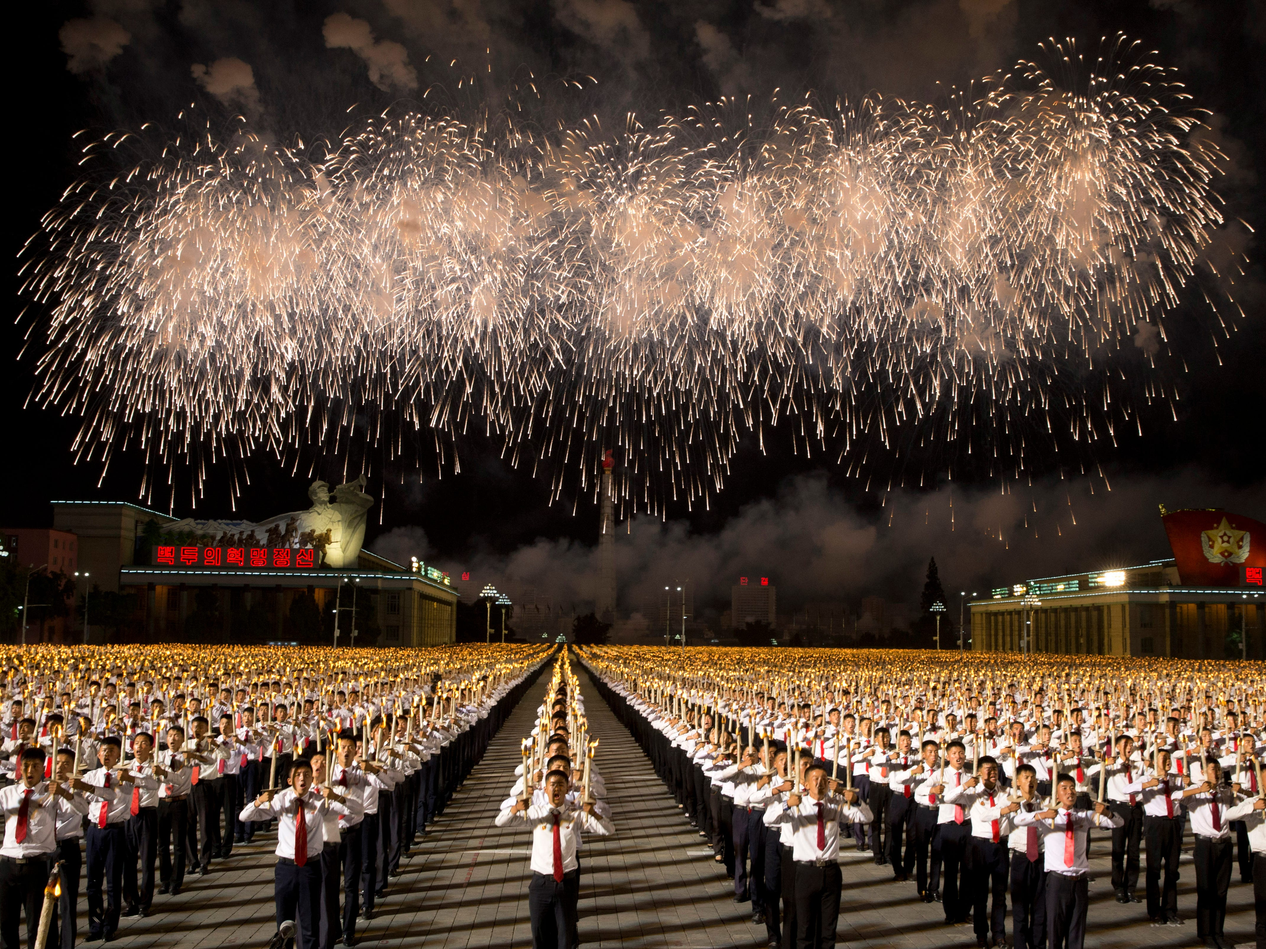 North Korean students take part in a torch light march held in conjunction with the 70th anniversary of North Korea's founding day celebrations in Pyongyang, North Korea, Monday, Sept. 10, 2018.