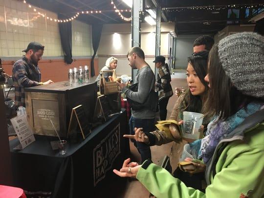 Folks sample hard cider at the 2017 Cider Slush event.