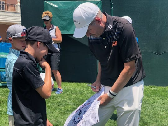 Tom Werkmeister signs autographs at the U.S. Senior Open.