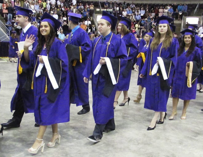 Graduating Elmira College students enter the First Arena in Elmira for the 2014 commencement ceremony.