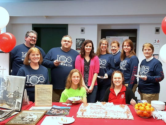 Staffers of Cornell Cooperative Extension of Steuben County celebrate  the agency's 100th birthday.